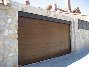 C mo reparar la puerta del garaje for Porte de garage pose en tunnel